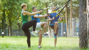 Two sporty man and woman doing gymnastic exercise outdoor.  stock video footage