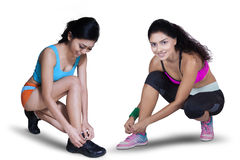 Two Sporty Woman Preparing to Run Royalty Free Stock Photography
