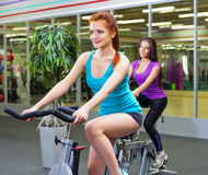 Two sporty women at fitness club Royalty Free Stock Image