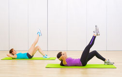 Two sporty women at fitness club Royalty Free Stock Photo