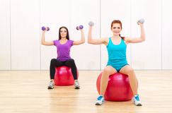 Two sporty women at fitness club Stock Photography