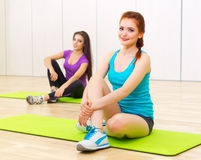 Two sporty women at fitness club Stock Photo