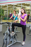 Two sporty women at fitness club Stock Photos