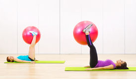 Two sporty women at fitness club Stock Image
