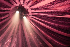 Two spotlights on fame. Two spotlights shining down under a red stripey circus tent royalty free stock images