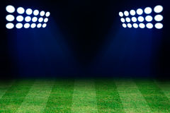 Two spotlights on football grass field Stock Photos