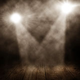 Two spotlights. In a room with wooden floor royalty free stock image