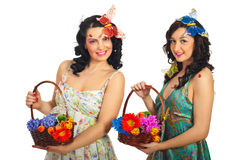 Two spring women with flowers Royalty Free Stock Image