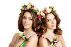 Two Spring women Young  Girl flowers Beautiful model wreath brac Stock Image