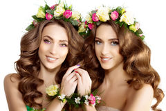 Two Spring women Young  Girl flowers Beautiful model wreath brac Stock Photography