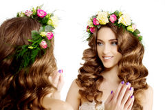 Two Spring women Young  Girl flowers Beautiful model wreath brac Stock Image