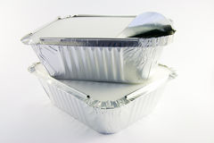 Two square foil catering trays one partly opened. 2 square foil catering trays 1 partly opened Stock Image