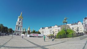 Between two squares in Kiev. KIEV, UKRAINE - SEPTEMBER 8, 2016: The walk along Vladimirskaya street from the St Michael Square to the St Sophia Square with the stock footage