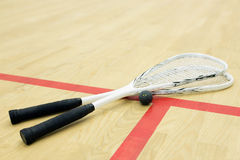 Two squash rackets and ball Stock Photography