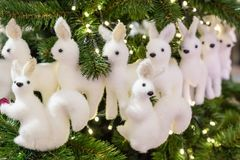 Two squirrel toy christmas white on the background lots of deer and branches. Of furry fur-trees Stock Photography