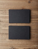 Two stack of blank black business cards on wooden background Vertical Royalty Free Stock Image