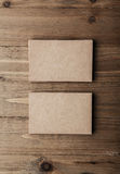 Two stack of blank craft business cards on wooden background Vertical Stock Photography