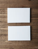 Two stack of blank white business cards on wooden background Vertical Stock Photo