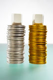 Two stack of silver and gold coins Royalty Free Stock Photos