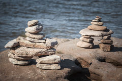 Two stacked stone cairns Stock Photo
