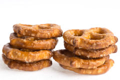 Two stacks of baked pretzels on white.. Close up photography of 2 stacks of baked pretzels on white stock photo