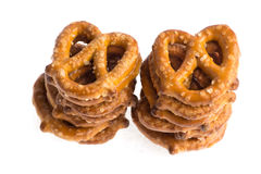 Two stacks of baked pretzels on white. Close up photography of 2 stacks of baked pretzels on white royalty free stock images