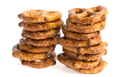 Two stacks of baked pretzels on white. Close up photography of 2 stacks of baked pretzels on white stock images