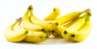 Two stacks of bananas composed next to each other on a white background Royalty Free Stock Image