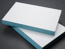 Two stacks of business cards on dark floor Stock Photography
