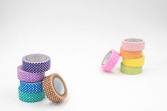 Two Stacks of Colorful Washi Tape on White Background. Horizontal Stock Photos