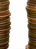 Two stacks of copper coins. Two stacks of coins (US penny) with copy space between them, isolated on white, clipping path included Royalty Free Stock Photos
