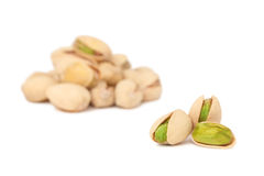 Two stacks of pistachios () Royalty Free Stock Photography