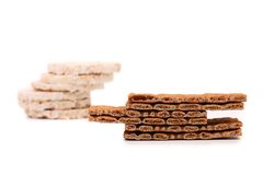 Two stacks. Puffed rice snack and crisp bread. Royalty Free Stock Photos