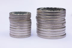 Two Stacks of Silver Coins. On profile. These are UK 5 and 10 pence pieces Royalty Free Stock Images