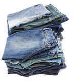 Isolated Jeans Stacks. Two stacks of various pairs of jeans pants isolated on white background Stock Image
