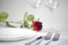 Two Stainless Steel Fork Beside Stainless Steel Butter Knife on the Table Stock Photo