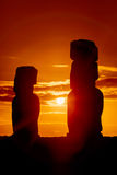 Two standing moais in red sunset. In Easter Island stock image