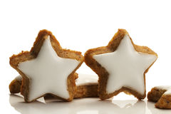 Two standing star shaped cinnamon biscuits Royalty Free Stock Image