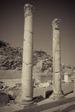 Two standing white marble columns in Greece Royalty Free Stock Photos