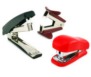 Two staplers and antistapler. Isolated on a white background Stock Photography