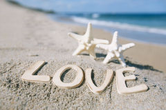 Two starfish with love message on Florida beach  under the sun l Royalty Free Stock Photography