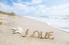 Two starfish with love message on Florida beach. Under the sun light, shallow dof Royalty Free Stock Images