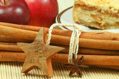 Two stars and cinnamon. Two stars in front od cinnamon sticks, apples and cake Stock Photography