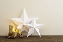 Two stars with gold candles. Two stars with three gold candles as Christmas deco Royalty Free Stock Images