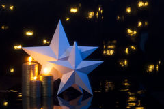 Two stars with gold candles. Two stars with three gold candles as Christmas deco Royalty Free Stock Image