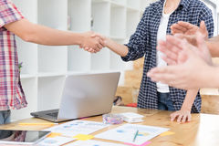 Two start up young people shaking hands after meeting while thei Royalty Free Stock Photo