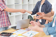 Two start up young people shaking hands after meeting while thei Royalty Free Stock Images
