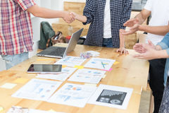 Two start up young people shaking hands after meeting while thei Stock Photography