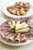 Two starter platters with smoked meat, cheese and shrimps Royalty Free Stock Image