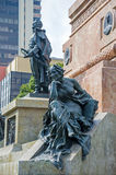 Two statues at the base of the Independence monument, Guayaquil, Ecuador Stock Photo